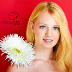 portrait of a young beautiful blonde girl with white flower